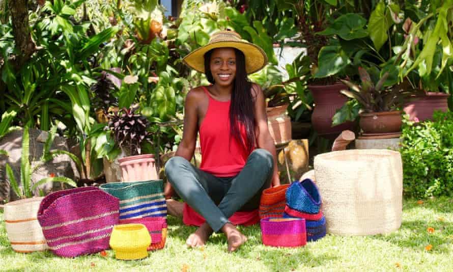 Akosua Afriyie-Kumi sat among her bags