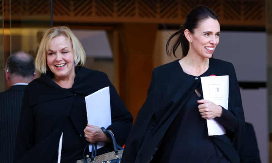 New Zealand National party leader Judith Collins (l) with prime minister Jacinda Ardern.
