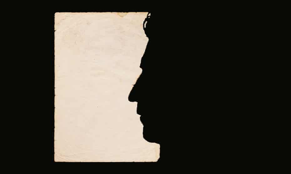 a face in silhouette on papyrus and black paper