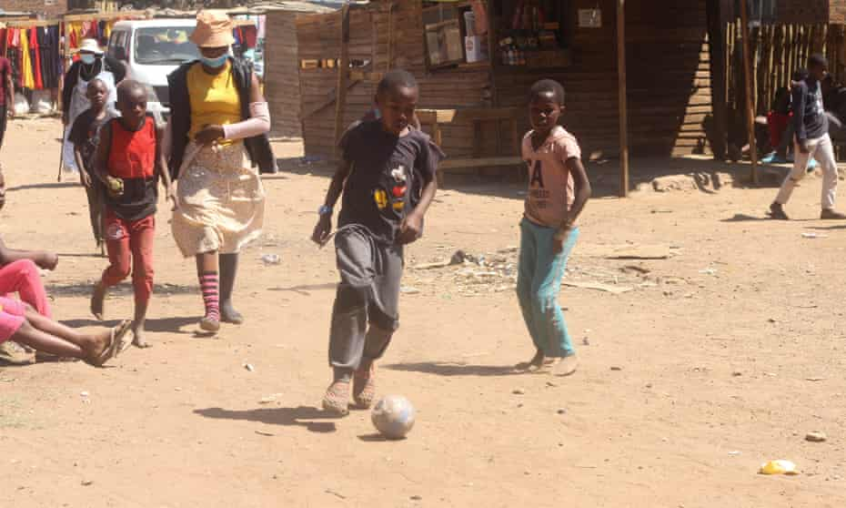 Tanaka Maunganidze, 9, plays football with his friends in Mbare, one of Zimbabwe's oldest townships.