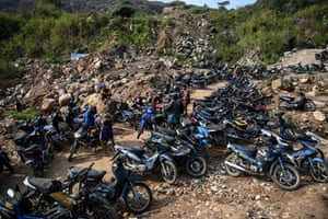 Miners arriving with equipment on motorcycles at a ruby mining site in Mogok, north of Mandalay