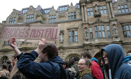 Campaigners calling for the removal of a statue of British imperialist Cecil Rhodes (upper right) at Oriel College in Oxford.