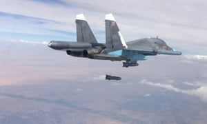 A Russian plane carries out an air strike in the Isis- controlled Al-Raqqah region of Syria.