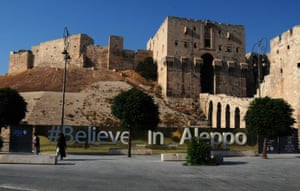 "An inscription reading ""Believe in Aleppo"" in front of the citadel"