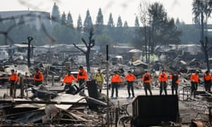 Search and rescue personnel look for human remains in the Journey's End Mobile Home park following the damage caused by the Tubbs fire.
