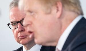Boris Johnson and Michael Gove (right) at the press conference.