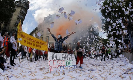 Tobacconist groups in a protest against plain cigarette packaging in Paris in July.