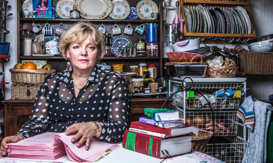 'At the beginning I felt bewildered': Elizabeth Watson at home. Her case file now runs to over 1,000 pages.