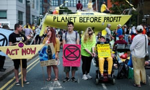 Extinction Rebellion members rally at an environmental protest in Leeds.