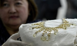 A government official shows a diamond-studded piece of jewellery seized from Imelda Marcos in 1986
