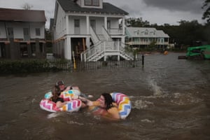 People float in floodwater