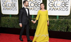 Natalie Portman in vintage Prada, with her husband, the choreographer Benjamin Millepied, at the Screen Actors Guild awards.