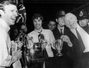 Best is flanked by Pat Crerand, left and manager Matt Busby as they celebrate with the European Cup following their historic victory over Benfica at Wembley in May 1968, the first English side to win the trophy.