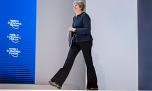 Theresa May walks on stage at the World Economic Forum in Davos.