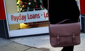 Person standing outside a shop offering payday loans