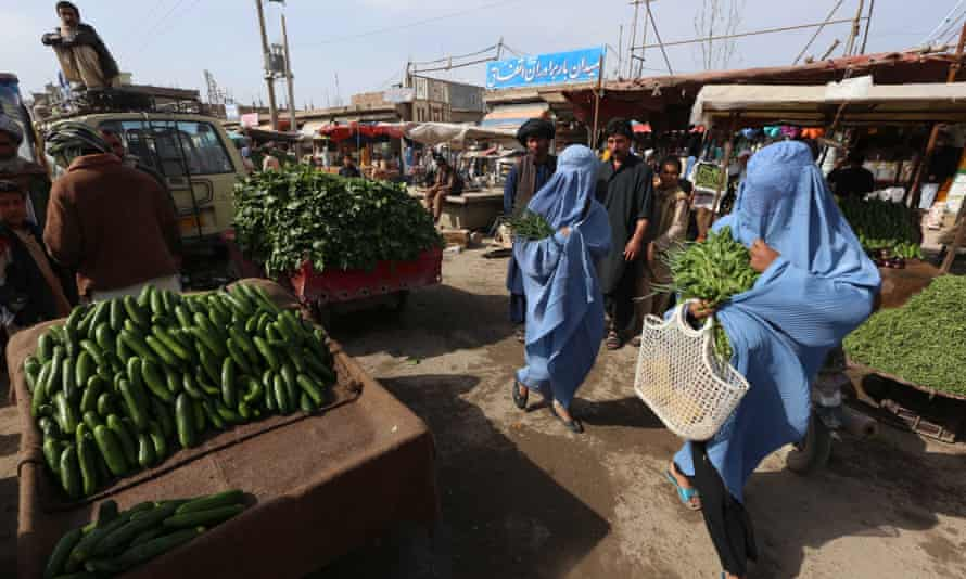 Women shopping at a market in Herat, Afghanistan.