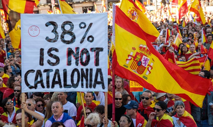 catalonia madrid warns of puigdemont jailing as thousands rally for