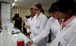 A CDC expert, center, works at a laboratory of the National Institute of Health in Bogota, Colombia.