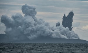 The Anak Krakatau volcano continues to throw out hot ash in a photograph taken from an Indonesian naval patrol boat on 28 December.