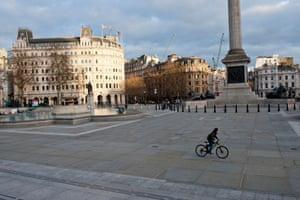 A lone cyclist in Trafalgar square in London