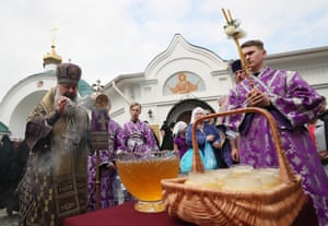 Yekaterinburg, Russia A Russian Orthodox priest blesses honey during celebrations of the Saviour of the Honey Feast day at the Cathedral of the Saviour