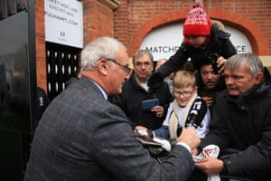 Fulham's new manager Claudio Ranieri signs autographs for fans before the game.