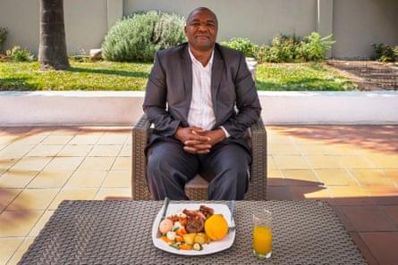 Farai Munyani, from the company Bayer Crop Science in Harare, Zimbabwe, with a full English breakfast