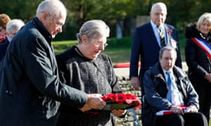 Linda Cook, granddaughter of L/Cpl Frederick Thomas Perkins, laying a poppy wreath during the burial service.