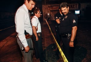 Homicide detectives and Sgt Hernandez from 77th Division assess a crime scene after a shooting