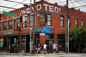 """A """"We voted!"""" mural in Atlanta, Georgia, features Stacey Abrams."""