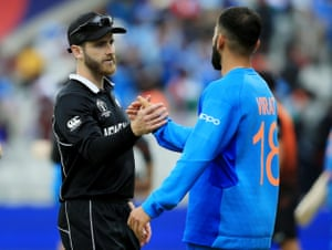 Kane Williamson consoles Virat Kohli at the end of the game.