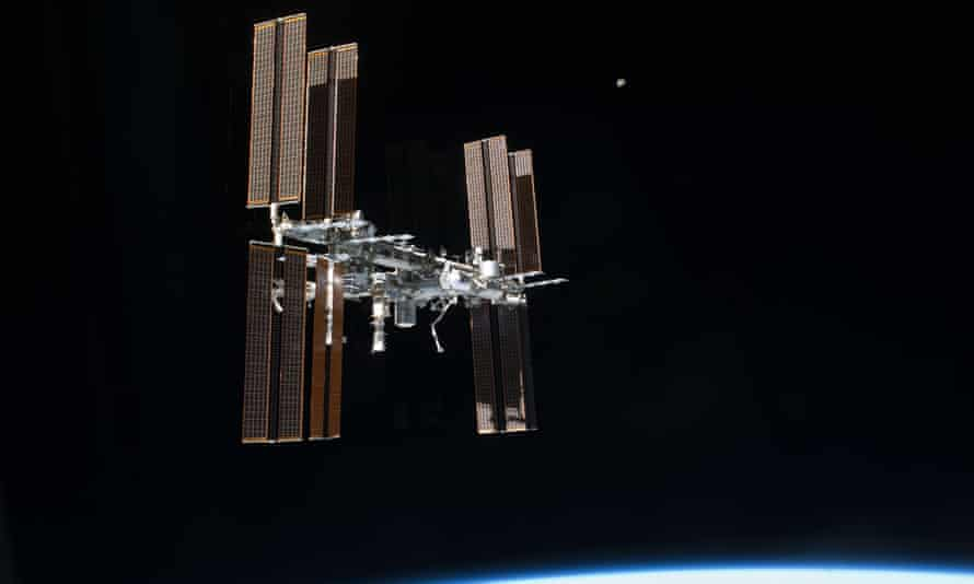 International Space Station transits the moon.