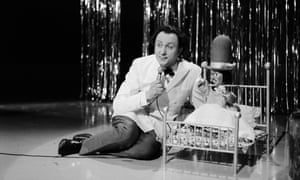 Ken Dodd sings with one of his Diddymen puppets on his TV show, circa 1968