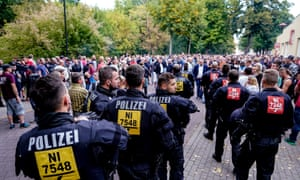Police officers watch on during a far-right protest in Koethen, south-west of Berlin.