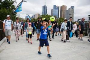 Fans arrive on day 1 of the Australian Open in Melbourne.