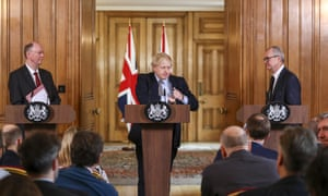 Boris Johnson flanked by Chris Whitty and Patrick Vallance during a news conference unveiling coronavirus emergency plans.