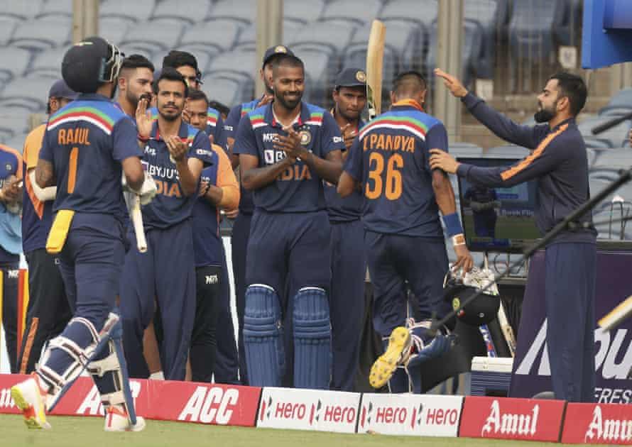 Teammates applaud Krunal Pandya from India as he walks away.