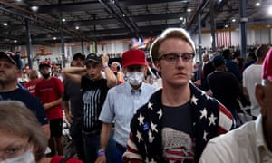 Supporters wait for Donald Trump during an indoor campaign rally at Xtreme Manufacturing in Henderson, a suburb of Las Vegas, Nevada.