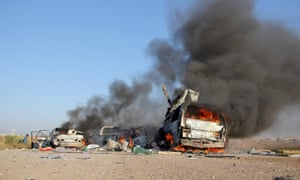 Burning vehicles after an air strike