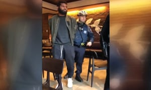 Video posted to social media shows police officers arresting two black men as they sat in a Starbucks coffee shop in Philadelphia.