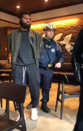 Video posted to social media shows police officers arresting Rashon Nelson and Donte Robinson (not pictured)