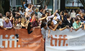 Scarlett Johansson fans attending the 2013 Tiff Film Festival Red Carpet Gala for Don Jon at the Princess of Wales Theatre on September 10, 2013 in Toronto, Canada. (Photo by Walter McBride/Corbis via Getty Images)