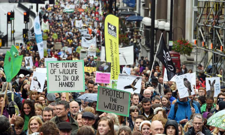Demonstrators march in the People's Walk for Wildlife in central London.