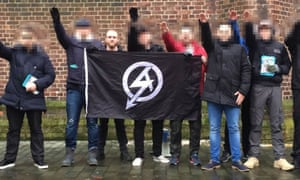 Christopher Lythgoe, who has been jailed for eight years, with the National Action flag and other supporters.