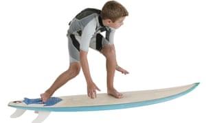 Boy riding a surfboard