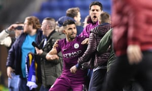 Sergio Agüero reacts after being confronted by a Wigan supporter following  Manchester City's FA Cup fifth-round defeat at the DW Stadium on Monday night