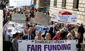 The marchers head down Whitehall towards Downing Street to deliver a letter to Philip Hammond
