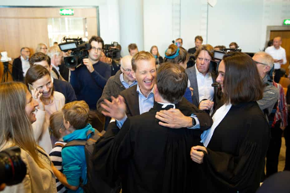 Campaigners celebrate at the Hague after the court of appeal upheld the historic climate ruling on the Dutch Government