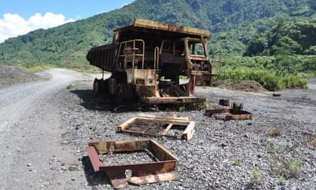 A mining truck rusts at Panguna mine.