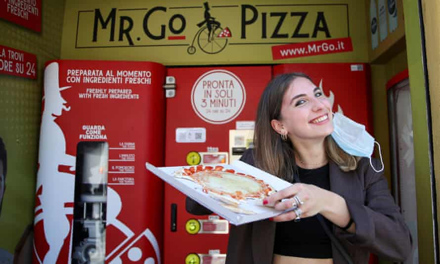 Fabrizia Pugliese poses with her order at the first automatic pizza vending machine in Rome.